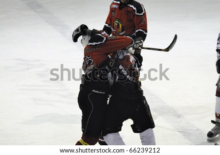 ZELL AM SEE, AUSTRIA - NOVEMBER 28: Salzburg hockey League. Fight between Gollackner and Hahn. Game SV Schuettdorf vs Devils Salzburg  (Result 2-13) on November 28, 2010, at hockey rink of Zell am See, Austria - stock photo