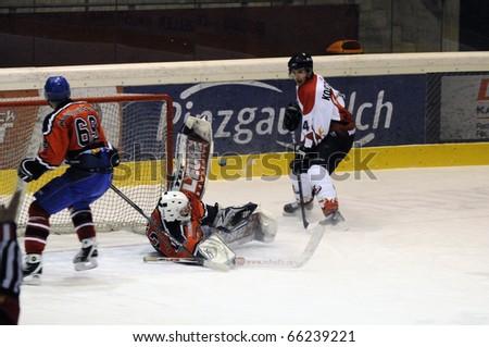 ZELL AM SEE, AUSTRIA - NOVEMBER 28: Salzburg hockey League. Great save by Goalie Hochwimmer. Game SV Schuettdorf vs Devils Salzburg  (Result 2-13) on November 28, 2010, at hockey rink of Zell am See, Austria - stock photo
