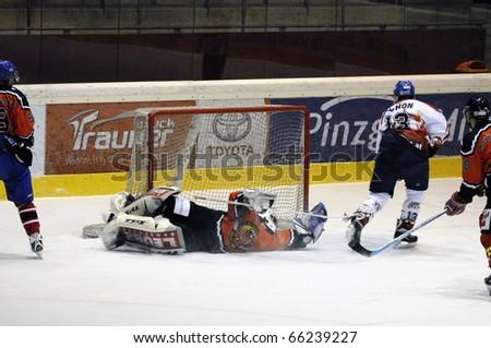ZELL AM SEE, AUSTRIA - NOVEMBER 28: Salzburg hockey League. Schoen scores for Salzburg in the third period. Game SV Schuettdorf vs Devils Salzburg  (Result 2-13) on November 28, 2010 in Zell am See, Austria - stock photo