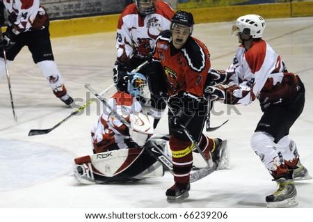 ZELL AM SEE, AUSTRIA - NOVEMBER 28: Salzburg hockey League. Unterberger gets crosschecked by Devils player. Game SV Schuettdorf vs Devils Salzburg (Result 2-13) on November 28, 2010, in Zell am See, Austria - stock photo