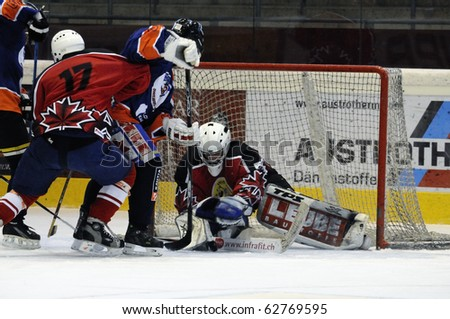ZELL AM SEE, AUSTRIA - SEPTEMBER 30: Austrian Icehockey Classic Tournament. Save by Goalie Peter Hochwimmer. Game Zell am See Oldies vs. Pallojussit (Result 3-3) on September 30, 2010 in Zell am See, Austria. - stock photo