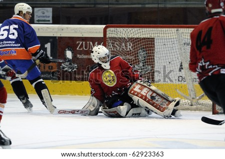 ZELL AM SEE, AUSTRIA - SEPTEMBER 30: Austrian Icehockey Classic Tournament. Save by Goalie Peter Hochwimmer. Game Zell am See Oldies vs. Pallojussit (Result 3-3) on September 30, 2010 in Zell am See - stock photo