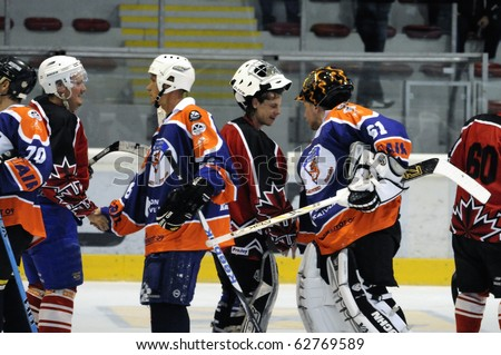 ZELL AM SEE, AUSTRIA - SEPTEMBER 30: Austrian Icehockey Classic Tournament. Shake-hands after the game. Game Zell am See Oldies vs. Pallojussit (Result 3-3) on September 30, 2010 in Zell am See, Austria. - stock photo