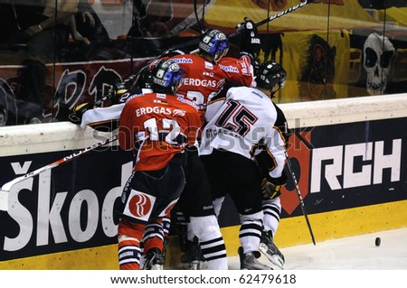 ZELL AM SEE; AUSTRIA - SEPTEMBER 4: Red Bull Salute Tournament Semifinal. Scrum at the boards.  Game between SC Bern and Eisbaeren Berlin (Result 1-5) on September 4, 2010. - stock photo