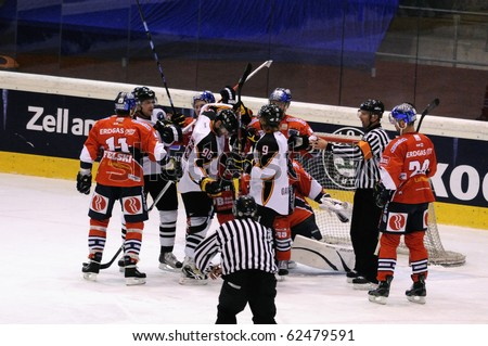 ZELL AM SEE; AUSTRIA - SEPTEMBER 4: Red Bull Salute Tournament Semifinal. Scrum in front of Berlin net.  Game between SC Bern and Eisbaeren Berlin (Result 1-5) on September 4, 2010. - stock photo