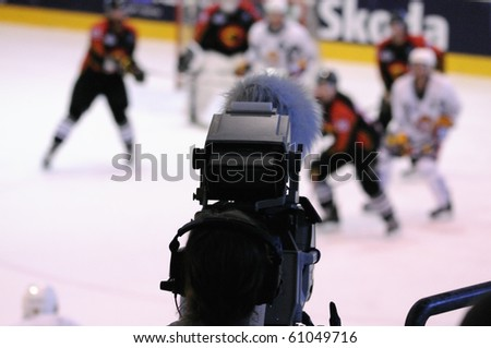 ZELL AM SEE, AUSTRIA - SEPTEMBER 3: Red Bulls Salute Tournament. TV Broadcast of Game Jokerit Helsinki vs. SC Bern (Result 0-2) on September 3, 2010 in Zell am See - stock photo