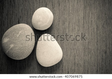 zen and spa stone on the plain wooden with copy space area. - stock photo