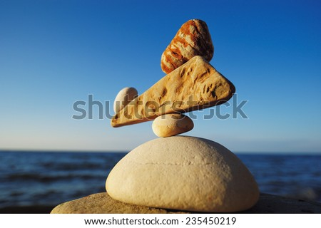 Zen balance of the stones on the seacoast - stock photo