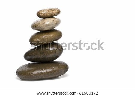 Zen balance with stones on a white background.