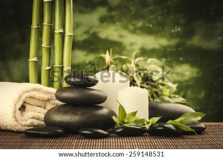 zen basalt stones and bamboo on the black - stock photo