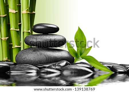 zen basalt stones and bamboo on the white - stock photo