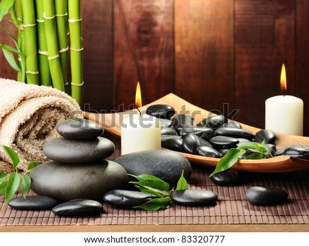 zen basalt stones and bamboo on the wood - stock photo