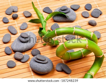 zen basalt stones and bamboo with dew - stock photo