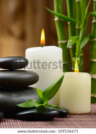 zen basalt stones and candle on the wood - stock photo