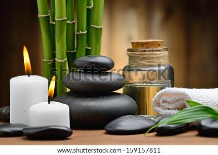 zen basalt stones and spa oil on the wood - stock photo