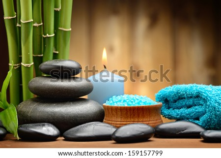 zen basalt stones and tonung sea crystals on the wood - stock photo