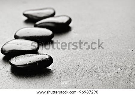 zen basalt stones  with dew - stock photo