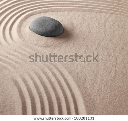 zen buddhism spiritual japanese rock garden abstract harmony and balance concept for purity concentration meditation and spa relaxation sand and stone background - stock photo