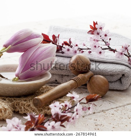 zen decor with flowers for spa treatment - stock photo