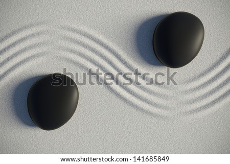 Zen garden on sand with two black stones separated by a drawing ripples - stock photo