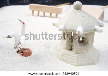 Zen garden stone with curves on sand - stock photo