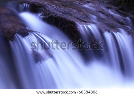 Zen garden waterfalls in dawn, slow shutter. - stock photo