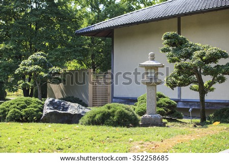 zen garden with japanese home in background