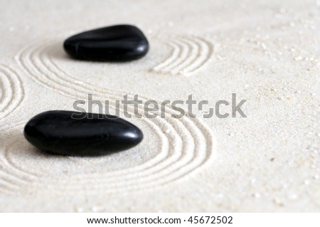 zen garden with sand stones and copyspace for a text message - stock photo