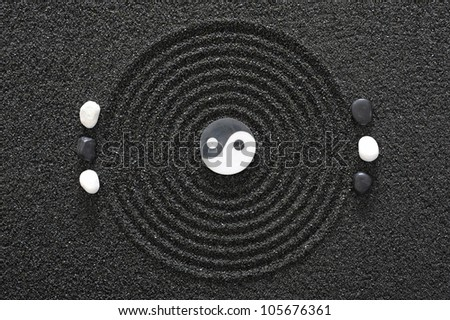 zen garden with stone of yin and yang - stock photo