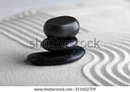 Zen garden with stones on sand background - stock photo
