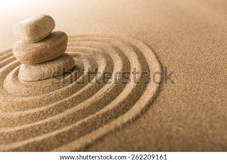 Zen. Japanese zen garden meditation stone for concentration and relaxation sand and rock for harmony and balance in pure simplicity  - stock photo