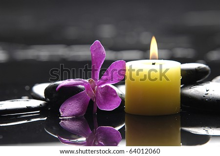 Zen-like scene with flower and candles and stones
