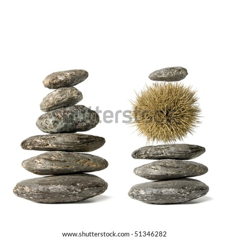 Zen-like stack of balanced stones isolated on white background.Available room for latter text. - stock photo