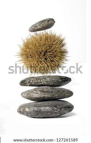 Zen-like stack of (un)balanced stones isolated on white background.Concept of inner difficulty. - stock photo