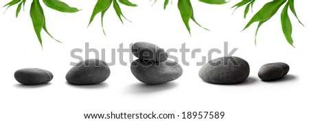 zen-like stones. pebbles and bamboo leaves on white background - stock photo