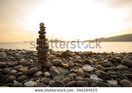 Zen meditation background,Balanced stones stack close up on sea beach - stock photo