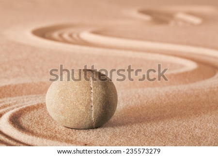 zen meditation stone sheng fui buddhism spiritual japanese rock garden abstract harmony and balance concept for purity concentration spa relaxation sand - stock photo