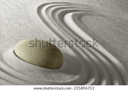 Zen meditation stone traditional Japanese garden with sand and rock pattern spa wellness in simplicity harmony and serenity helps in concentration and relaxation - stock photo