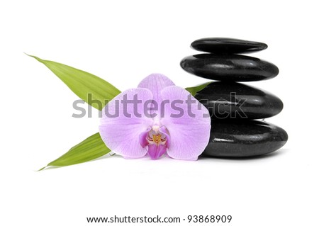 Zen pebbles balance. Pink orchid and bamboo leaf - stock photo