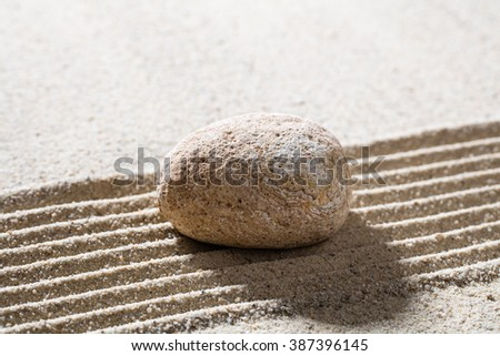 zen sand still-life - textured pebble on straight lines for concept of concentration or tranquility  - stock photo