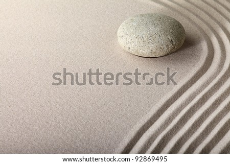 zen sand stone garden japanese meditation relaxation and spa image spiritual balance round rock raked lines and pattern to meditate and relax background with copy space - stock photo