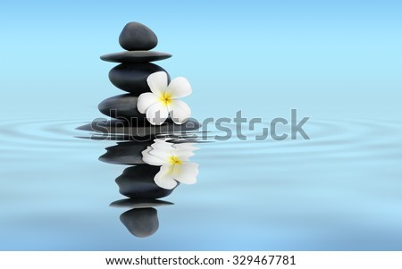 Zen spa concept panoramic banner image - Zen massage stones with frangipani plumeria flower in water reflection - stock photo