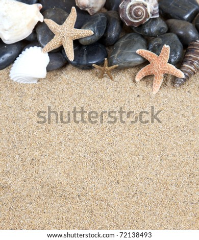 zen spa river rocks and shells on sand in form of border - stock photo