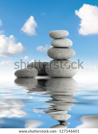 zen spa stones with gray sky and water