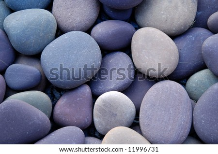 Zen stack of pebbles on the beach - stock photo