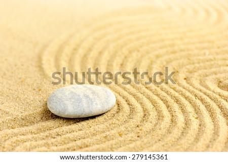Zen stone at of sand background - stock photo