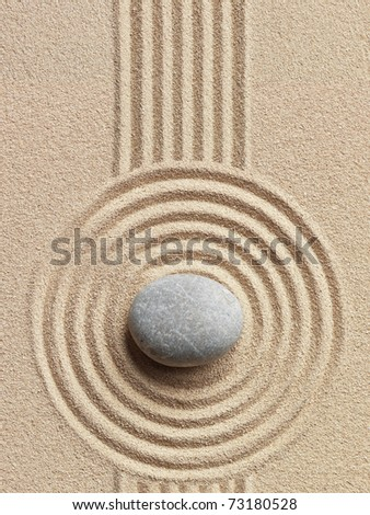 Zen stone in the sand. Background - stock photo