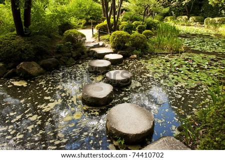 Zen stone path in a Japanese Garden near Heian Shrine. Heian Shrine is one of biggest Japanese buddhist temples in Kyoto. Japan - stock photo
