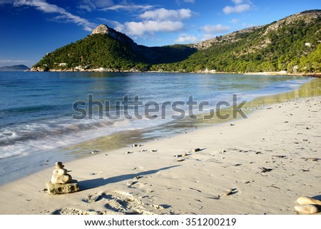 zen stones and formentor beach in Majorca Spain - stock photo