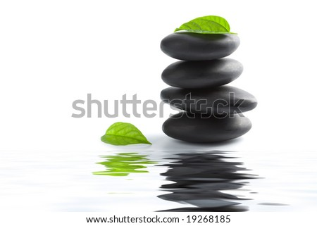 zen stones and leaves reflecting in water isolated - stock photo